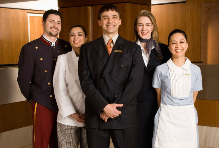 Hospitality professionals standing together in a group.