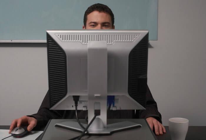 Man sitting behind desktop computer