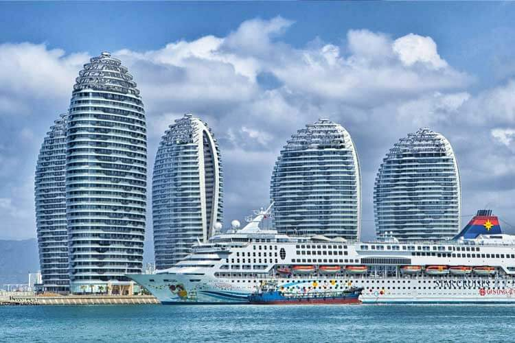 Hotel buildings and a cruise ship to promote Hospitality Career Online Classes
