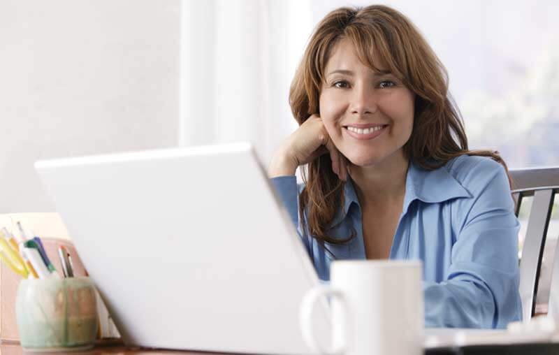 Woman training at home during a bad economy with a computer.